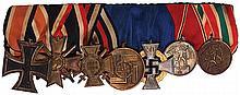 German medal bar, 8.3'' l., Iron Cross 1939 2nd class; War Merit Cross 1939, 2nd class; Hindenburg Cross; SS Long Service Award 8 Year; 50 Year Faithful Service, Civil; Austrian Anschluss Medal; Return of Memel District, good condition