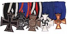 German medal bar, 6.0'' l., Iron Cross 1914 2nd class; War Merit Cross Oldenburg; Hindenburg Cross; 25 Year Faithful Service, Civil; Prussian 15 Year Military Service, good condition