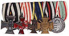 German medal bar, 6.0'' l., Iron Cross 1914 2nd class; Hanseatic Cross Bremen; Brunswick Cross for Military Merit Combatant Ribbon; Hindenburg Cross; WWI Service in Hungary Medal, good condition