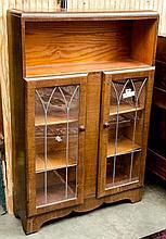 Oak bookcase w/ glass doors- approx 36