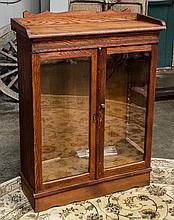 Two glass door small oak bookcase 32