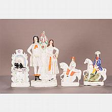 A Group of Four English Staffordshire Porcelain Figures, Late 19th Century.