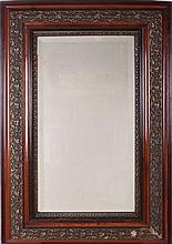An American Mahogany and Plaster Beveled Mirror Having Grape Motif, 19th Century.