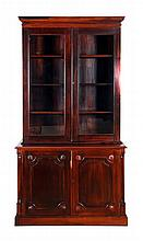 A Georgian Style Mahogany Bookcase with Shell Carvings, 19th/20th Century.