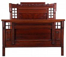 A Victorian Carved Walnut Bed, 19th Century.