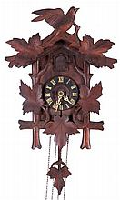 A German Carved Walnut Cuckoo Clock, Early 20th Century.