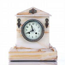 A French Onyx and Brass Mantle Clock, 19th Century.