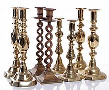 A Miscellaneous Collection of Eight Brass Candlesticks, 20th Century.