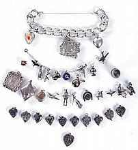 A Miscellaneous Collection of Sterling Silver Charms and Charm Bracelet, 19th/20th Century.