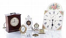 A Miscellaneous Collection of Decorative Porcelain, Wood, and Brass Clocks, 20th Century.