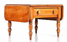 An American Tiger Maple Drop Leaf Low Table, 19th Century.