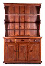 An American Tiger Maple Set-Back Cupboard, 19th Century.