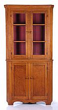 An American Tiger Maple Corner Cupboard, 19th Century.