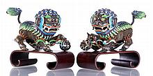 A Pair of Chinese Silver Filigree and Enamelled Foo Dogs, 19th Century,