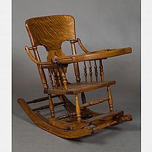 A Victorian Oak Transforming High Chair and Rocking Chair, 19th Century.