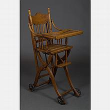 A Victorian Oak Transforming Doll's Rolling High Chair and Stroller, 19th Century.