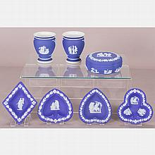 A Collection of Seven Wedgwood Dark Blue Jasperware Decorative Items, 20th Century,