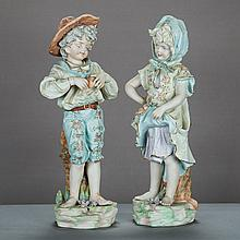 A Pair of Continental Bisque Porcelain Figures, 20th Century,