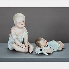 Two Continental Bisque Piano Babies, 19th Century.