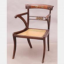 A Regency Mahogany Armchair with Caned Seat, 19th Century.