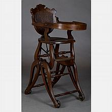 A Victorian Walnut Transforming Doll's Rolling High Chair and Stroller, 19th Century.