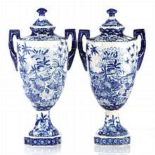 A Pair of Chinese Blue and White Porcelain Lidded Urns, 20th Century.