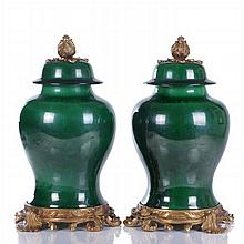 A Pair of Chinese Green Porcelain Lidded Vessels with Bronze Base and Finials, 20th Century.