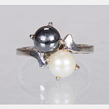 A 10kt. White Gold, White and Black Pearl Ring,