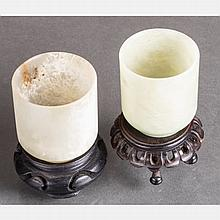 Two Chinese Carved Jade Cups on Carved Hardwood Stands.