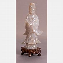 A Chinese Carved Nephrite Jade Figure of Guanyin on a Carved Hardwood Stand.
