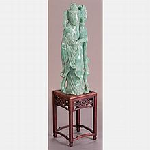A Chinese Carved Green Nephrite Jade Figure of Guanyin on Carved Hardwood Stand.