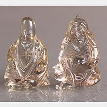 Two Chinese Carved Rock Crystal Figures.