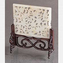 A Chinese Carved White Jade Table Screen on a Carved Rosewood Stand.