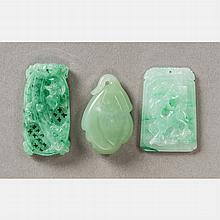 A Group of Three Chinese Carved Jade Pendants.