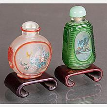 Two Peking Glass Snuff Bottles with Painted Interiors on Carved Hardwood Stands,