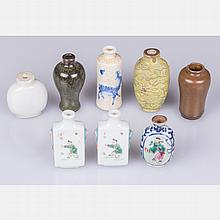 A Collection of Eight Chinese Porcelain and Stoneware Snuff Bottles, 19th/20th Century.