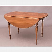 An American Pine Drop Leaf Table, 20th Century.