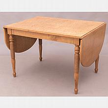 An American Tiger Maple Drop Leaf Table, 20th Century.