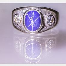 A 10kt. White Gold, Cabochon Cut Linde Star Sapphire and Diamond Ring,
