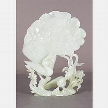 A Chinese Carved White Jade Figural Group Depicting Two Peacocks, 20th Century.