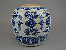 An Antique Chinese Blue & White Porcelain Jar The blue & white porcelain ginger jar centering a band of alternating stylized lotus and foliate motifs and calligraphy and raised on the integral foot.Size: 7 3/4
