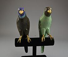 A Pair of Chinese Cloisonne Parrot Figures Comprising one green example and one black example.Size: 11