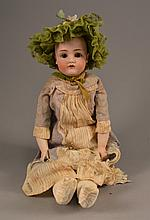 An Antique German Porcelain Doll Marked DEP, lacking hair, and having porcelain lower arms.Size: 20