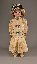 An Antique German Porcelain Doll Having blue eyes, the body with ball joints, the head marked to reverse 109-10 1/2 X, Handwerck, Germany, and 2 1/4.Size: 19