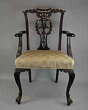 A Set of Edwardian Mahogany Chairs Circa early 20th centuryIn the Chippendale style, the set of carved mahogany chairs comprising two arm chairs and six side chairs, each with metal placard beneath seat frame reading Alfred Taylor & Sons, House Furni