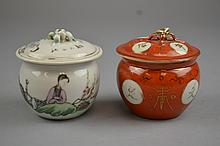 A Pair of Chinese Covered Porcelain Pots Republic PeriodEach of squat, bulbous form, the first decorated in famille rose enamels and calligraphy, the second with gilt painted calligraphy medallions over the coral ground throughout.Size: 2 3/4