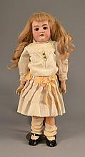 An Antique German Porcelain Doll Having brown eyes, the body with ball joints. Size: 18