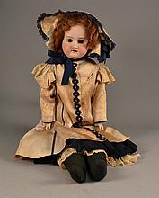 An Antique German Porcelain Doll The head and bust marked to reverse DRGM 377439, Made in Germany, DEP, and having associated numerals, the body of kid leather with porcelain hands. Size : 25