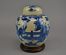 A 19th Century Chinese Blue & White Ginger Jar The porcelain ginger jar decorated in underglaze blue over the crackled glaze, depicting figures in a garden scene and surmounted by the similarly decorated lid, the base with six character mark, the
