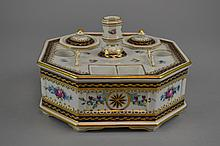 A Sevres Style Porcelain Ink Stand Of octagonal form, having gilt painted and enameled floral details throughout, comprising two removable covered wells, integral candle holder, stamp receptacles, and pen tray, the interior with apocryphal Sevres